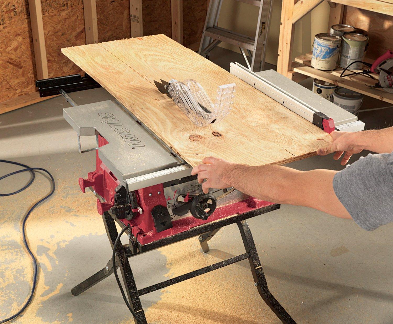 man using a saw